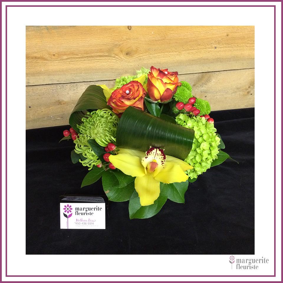 Bouquet orangé et vert à partir de 45.00$
