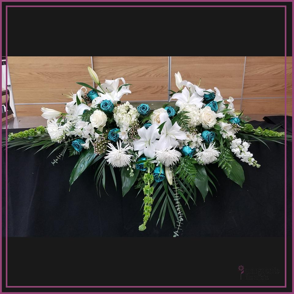 Coussin pour urne avec rose éternel turquoise